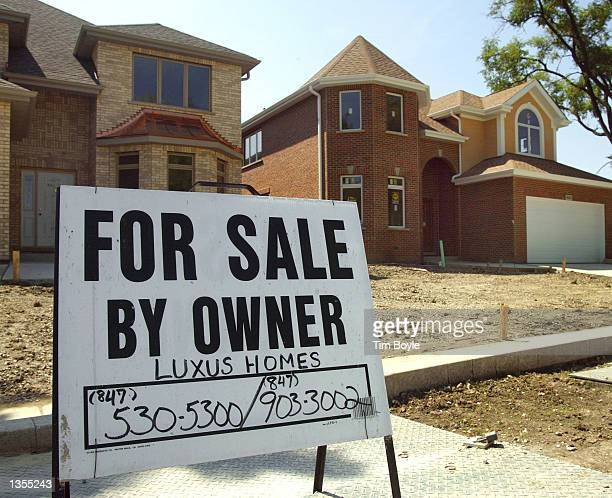 New homes under construction for sale by owner are shown August 26 2002 in Des Plaines Illinois Newhome sales in the US reached a record level in...