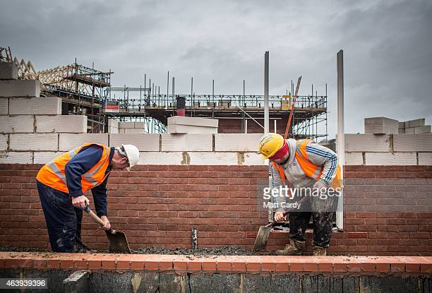 New houses are constructed on a residential housing development in Bideford on February 19 2015 in Devon England The issues affecting the housing...