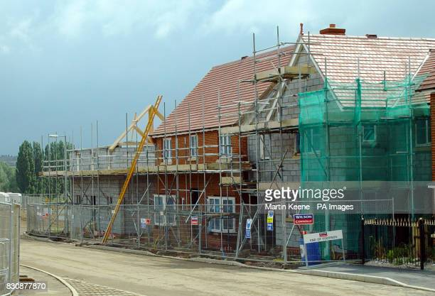 New houses under construction August 2002 at Oakwood Park near the village of Little Dunmow in Essex where 650 dwellings are being built on the...