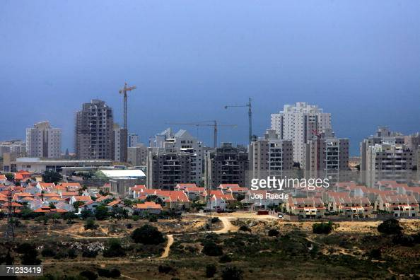 New housing projects tower over a residential neighborhood May 29 2006 in the southern Israeli city of Ashkelon Prime Minister Ehud Olmert today...