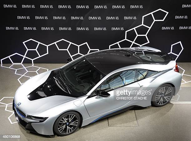 A new i8 plugin hybrid sports car developed by German car manufacturer BMW is parked at the BMW world delivery center in Munich southern Germany on...