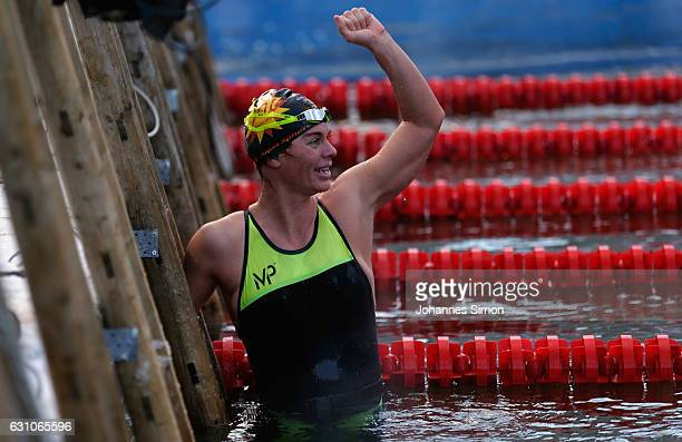 New ice swimming world champion Julia Wittig of Germany celebrates after winning the women's races finals in Woehrsee lake on January 6 2017 in...