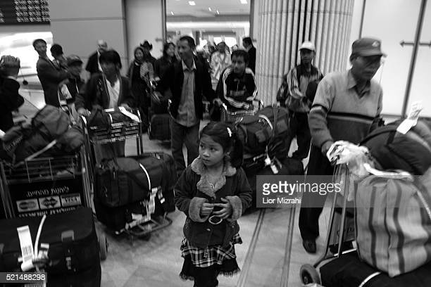 New immigrants from the 'Bnei Menashe' tribe arrives in Ben Gurion International Airport in Lod as they emigrate from India to Israel Tuesday...