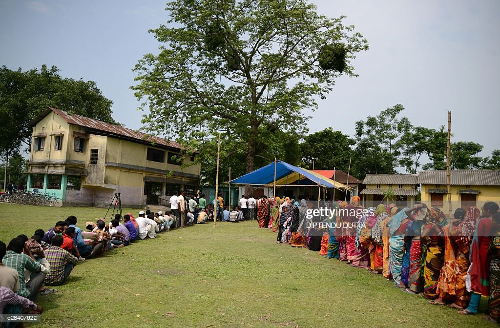 New Indian citizens of Masaladanga and nearby enclaves queue up to caste their ballots in Cooch Behar district on May 5, 2016, as they vote in the final phase of state assembly elections in the eastern Indian state of West Bengal. Those in the queue are among many who became Indian citizens after a transfer of enclaves between India and Bangladesh in 2015, when India and Bangladesh signed a Land Boundary Agreement. Under the agreement Bangladesh had transferred 51 enclaves to India while India transferred 111 to Bangladesh / AFP / DIPTENDU