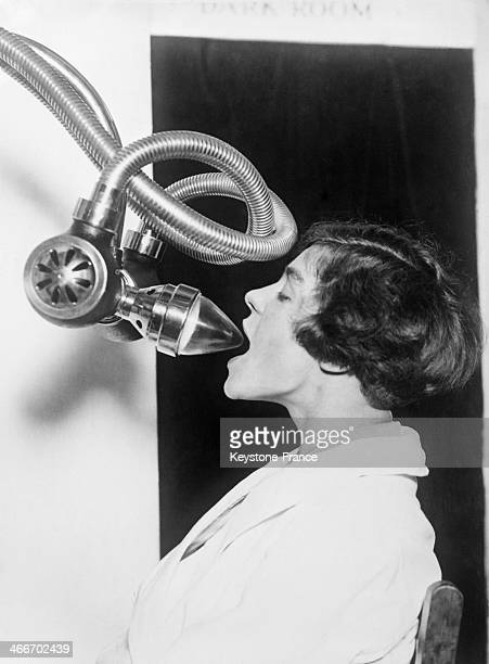 A new invention enabling to X ray the inside of a patient's mouth has caused a stir at the Medical Exhibition circa 1920 in London United Kingdom