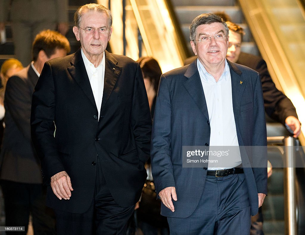 New IOC President <a gi-track='captionPersonalityLinkClicked' href=/galleries/search?phrase=Thomas+Bach&family=editorial&specificpeople=610149 ng-click='$event.stopPropagation()'>Thomas Bach</a> (R) and <a gi-track='captionPersonalityLinkClicked' href=/galleries/search?phrase=Jacques+Rogge&family=editorial&specificpeople=206143 ng-click='$event.stopPropagation()'>Jacques Rogge</a> (L) arrive at Frankfurt Airport on September 12, 2013 in Frankfurt am Main, Germany.