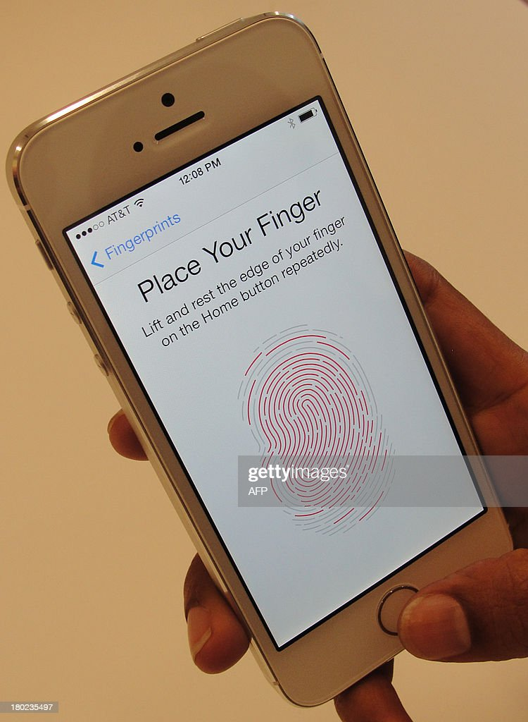 New iPhone 5S handsets let people use their fingerprints to unlock the smartphones at an iPhone event at Apple's headquarters in Silicon Valley on September 10, 2013 in Cupertino, California. Apple unveiled two new iPhones on Tuesday in its bid to expand its share of the smartphone market, including one as low as $99 with a US carrier contract. 'The business has become so large that this year we are going to replace the iPhone 5 and we are going to replace it with two new designs,' Apple chief Tim Cook announced at the company's Silicon Valley headquarters. Apple will begin taking orders on Friday, and on September 20 the two devices will go on sale in the United States, Australia, Britain, China, France, Germany, Japan and Singapore.
