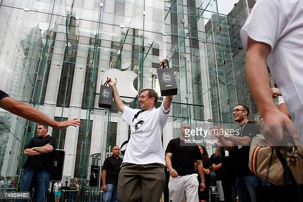 New iPhone owners exit Apple's flagship store on Fifth Avenue on June 29 2007 in New York City Hype for the iPhone which costs $499 or $599 has...