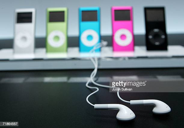 New iPod earphones are seen next to a display of the new iPod Nano at an Apple media event September 12 2006 in San Francisco Apple CEO Steve Jobs...
