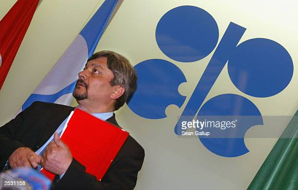 New Iraqi Oil Minister Ibrahim Bahr alUloum stands next to the OPEC logo as he arrives for a news conference prior to the 127th meeting of OPEC oil...