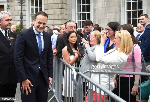 New Irish Taoiseach Leo Varadkar reacts as a well wisher takes a photograph at Leinster House after being elected as Taoiseach on June 14 2017 in...