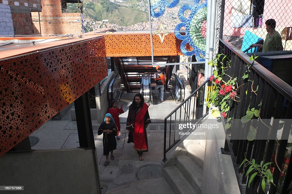 New Israelites dressed in wear Old Testament costumes use the escalators in '20 de Julio' neighborhood in the Comuna 13 slums on January 5, 2013 in Medellin, Colombia. The stairway is divided into six sections and has a length of 1,260 feet. An escalator goes up and a second goes down.Residents used to climb hundreds of steps to get home from the bottom of the hill, but the journey now takes just 6 minutes. Comuna 13 is the most notorious slums of Medellin with violence occurring everyday.