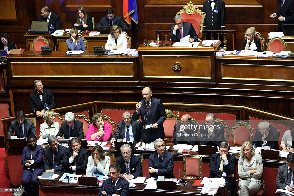 New Italian Prime Minister <a gi-track='captionPersonalityLinkClicked' href=/galleries/search?phrase=Enrico+Letta&family=editorial&specificpeople=2915592 ng-click='$event.stopPropagation()'>Enrico Letta</a> (C) delivers his speech during the confidence vote at the Senate on April 30, 2013 in Rome, Italy. The new coalition government was formed through extensive cooperation agreements between the right and left coalitions after a two-month long post-election deadlock.