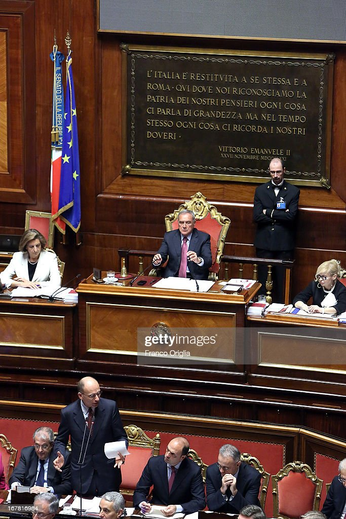 New Italian Prime Minister <a gi-track='captionPersonalityLinkClicked' href=/galleries/search?phrase=Enrico+Letta&family=editorial&specificpeople=2915592 ng-click='$event.stopPropagation()'>Enrico Letta</a> (L) delivers his speech during the confidence vote at the Senate on April 30, 2013 in Rome, Italy. The new coalition government was formed through extensive cooperation agreements between the right and left coalitions after a two-month long post-election deadlock.