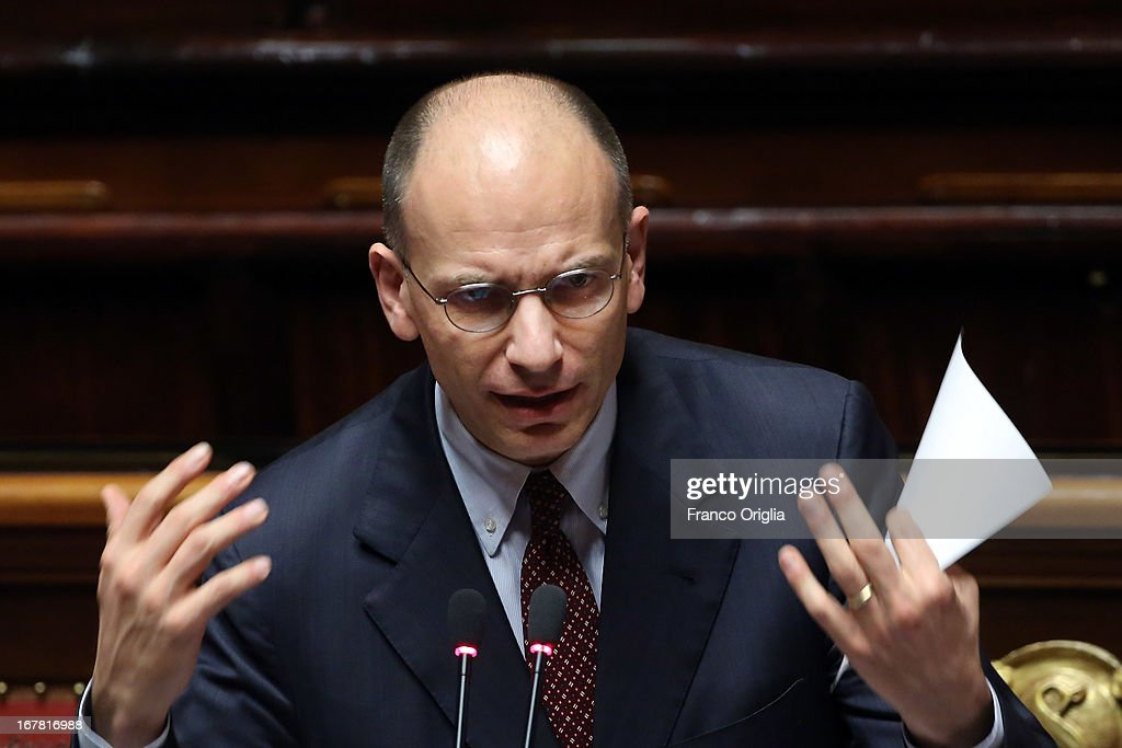 New Italian Prime Minister <a gi-track='captionPersonalityLinkClicked' href=/galleries/search?phrase=Enrico+Letta&family=editorial&specificpeople=2915592 ng-click='$event.stopPropagation()'>Enrico Letta</a> delivers his speech during the confidence vote at the Senate on April 30, 2013 in Rome, Italy. The new coalition government was formed through extensive cooperation agreements between the right and left coalitions after a two-month long post-election deadlock.
