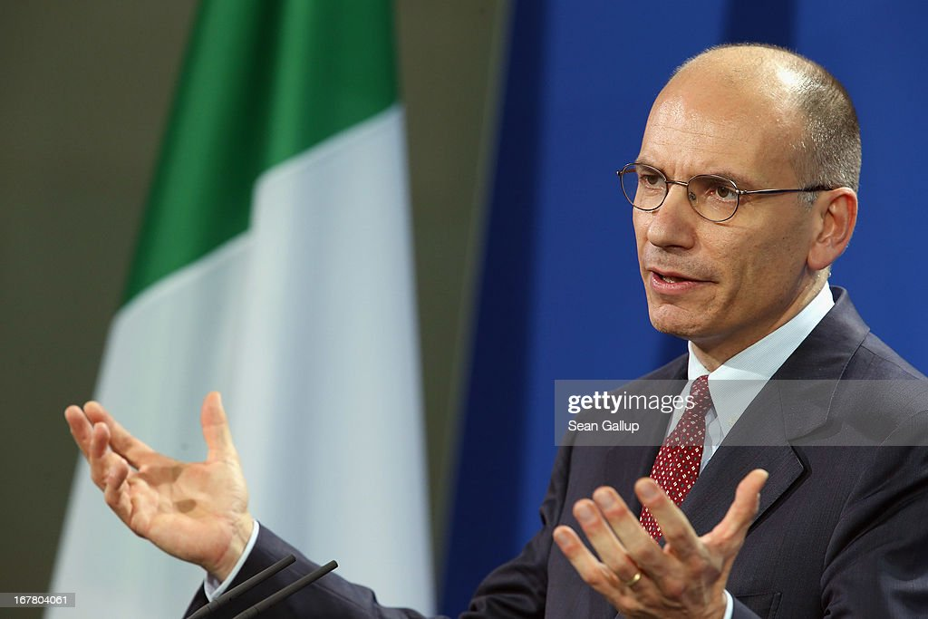 New Italian Prime Minister <a gi-track='captionPersonalityLinkClicked' href=/galleries/search?phrase=Enrico+Letta&family=editorial&specificpeople=2915592 ng-click='$event.stopPropagation()'>Enrico Letta</a> speaks to the media with German Chancellor Angela Merkel (not pictured) following talks at the Chancellery on April 30, 2013 in Berlin, Germany. Letta is in Germany on his first official foreign visit abroad since taking office. The two leaders discussed the current financial situation in Europe.
