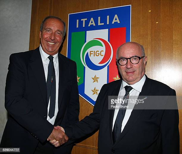 New Italy head coach Giampiero Ventura shakes the hand with FIGC President Carlo Tavecchio on June 8 2016 in Rome Italy