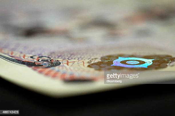 A new Japanese 5000 yen banknote which has a hologram larger than the current design and with a new texture sits on display following the unveiling...