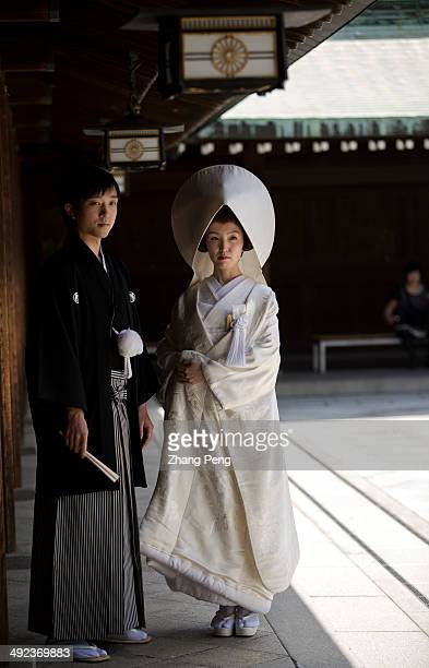 A new Japanese couple have their traditional wedding ceremony in Meiji Jingu