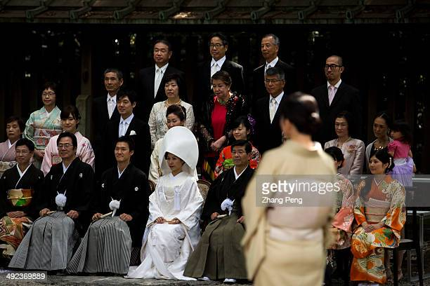 A new Japanese couple have their traditional wedding ceremony in Meiji Jingu After the ceremony usually the whole family will take a group photo for...