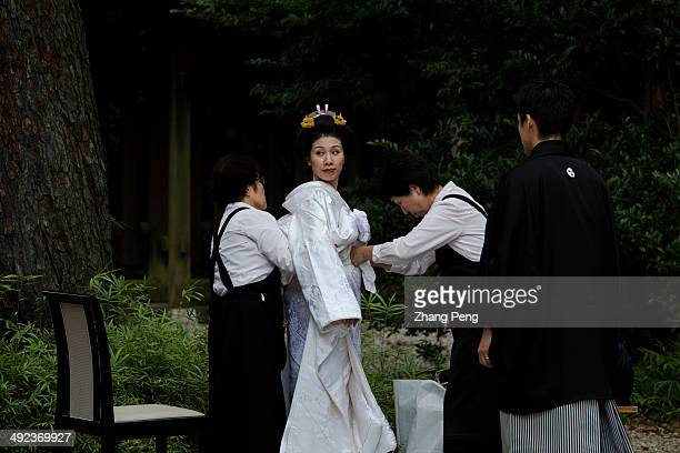 A new Japanese couple have their traditional wedding ceremony in Meiji Jingu The bride is wearing a traditional wedding dress
