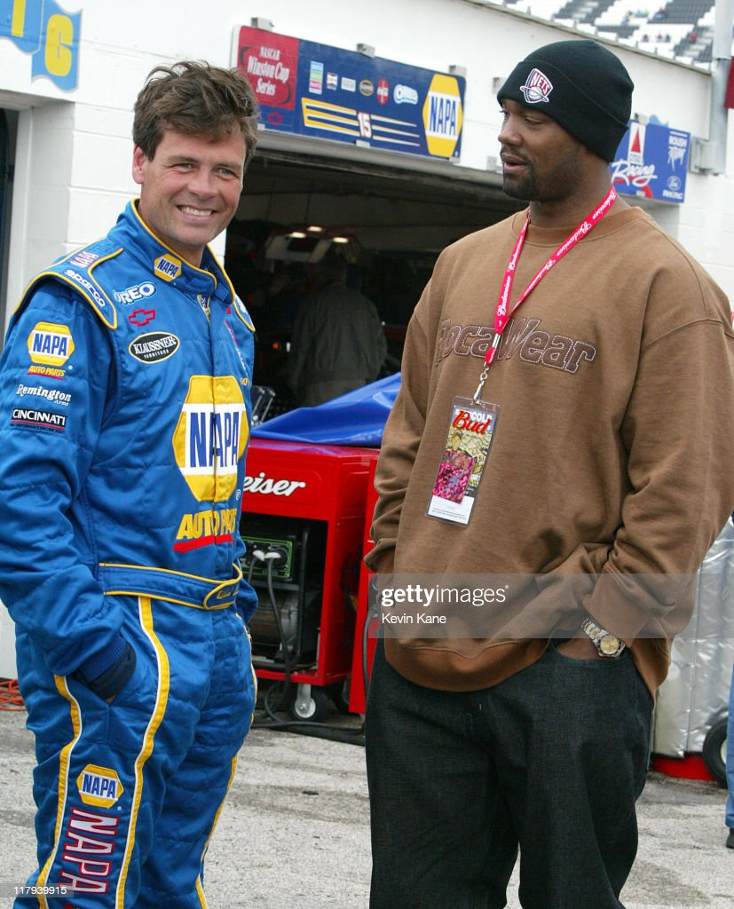 New Jersery Nets forward Rodney Rogers talks with NASCAR Winston Cup driver Michael Waltrip during Daytona 500 practice