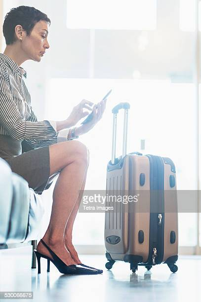 USA, New Jersey, Businesswoman at the airport using tablet