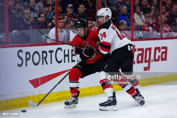New Jersey Devils Center Adam Henrique attempts to force Ottawa Senators Center JeanGabriel Pageau off the puck during second period National Hockey...