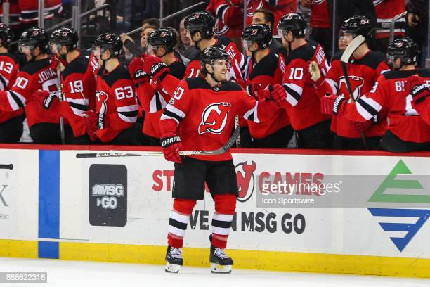 New Jersey Devils center Blake Coleman comes to the bench after scoring during the second period of the National Hockey League game between the New...