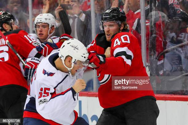New Jersey Devils center Blake Coleman fights Washington Capitals left wing Andre Burakovsky during the National Hockey League game between the New...