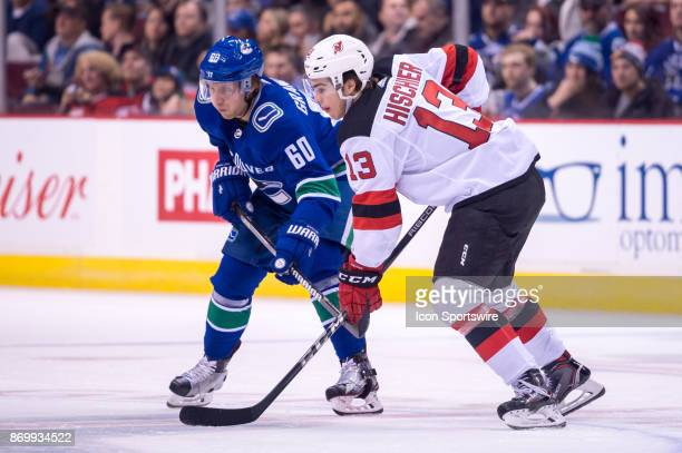 New Jersey Devils Center Nico Hischier and Vancouver Canucks Center Markus Granlund watch a faceoff during their NHL game at Rogers Arena on November...