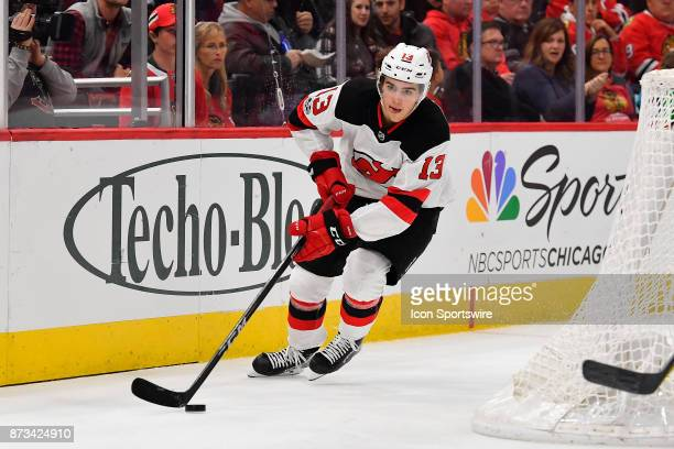 New Jersey Devils center Nico Hischier clears the puck during the game between the New Jersey Devils and the Chicago Blackhawks on November 12 2017...