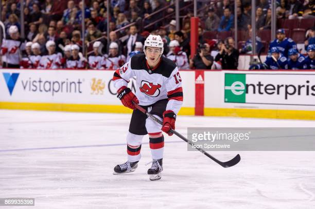 New Jersey Devils Center Nico Hischier skates up ice during their NHL game against the Vancouver Canucks at Rogers Arena on November 1 2017 in...