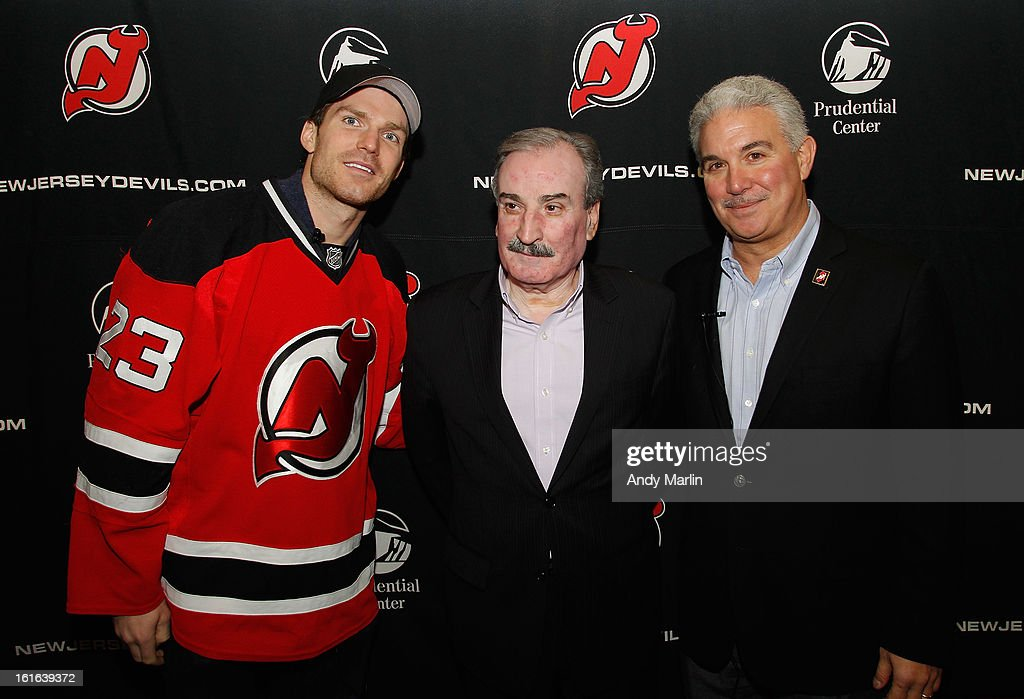 New Jersey Devils' David Clarkson (L) council member-east ward Augusto Amador (C) and Devils owner Jeff Vanderbeek pose for a photo during the Hockey in Newark instructional clinic on February 13, 2013 in Newark, New Jersey.