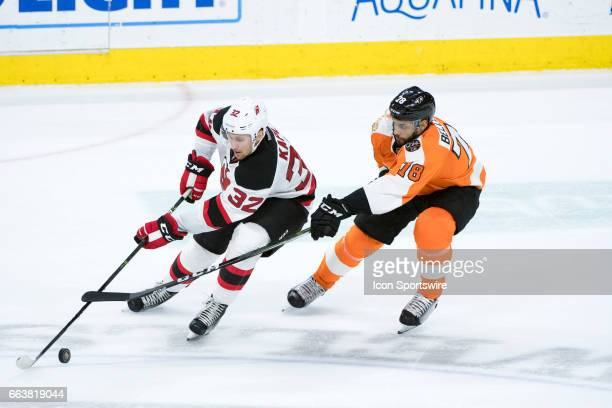 New Jersey Devils Defenceman Michael Kapla keeps the puck from Philadelphia Flyers Center PierreEdouard Bellemare in the first period during the game...