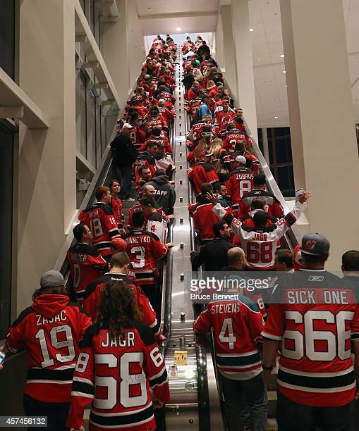 New Jersey Devils fans arrive for the home opener against the San Jose Sharks at the Prudential Center on October 18 2014 in Newark New Jersey