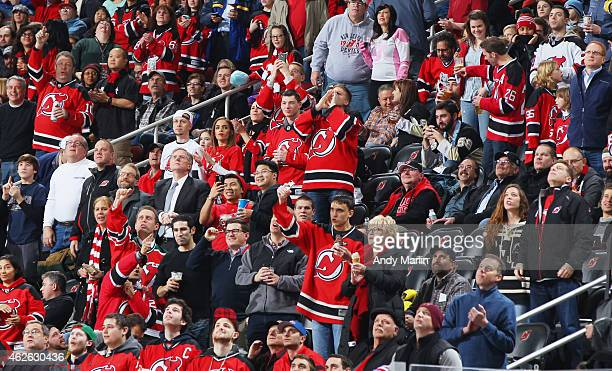 New Jersey Devils fans celebrate a devils goal against the Pittsburgh Penguins during the game at the Prudential Center on January 30 2015 in Newark...