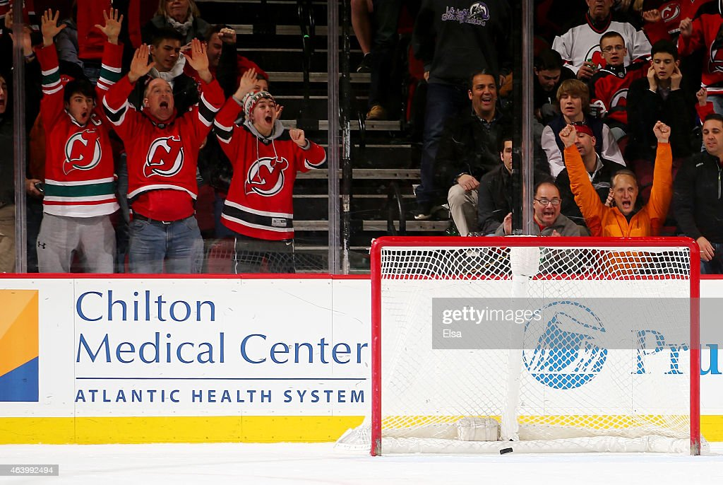 New Jersey Devils fans celebrate an empty net goal by Mike Cammalleri of the Devils in the third period against the Vancouver Canucks on February 20...