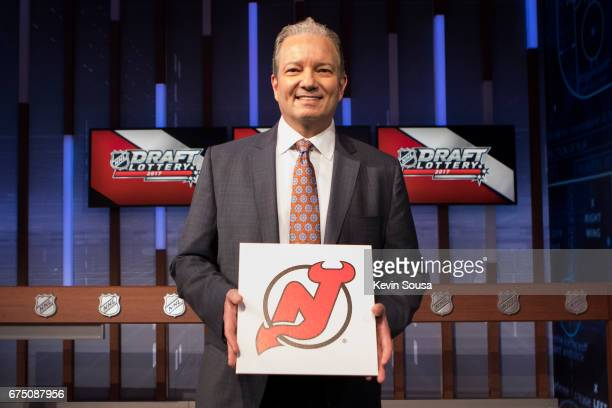 New Jersey Devils General Manager Ray Shero shows off the first overall pick during the NHL Draft Lottery at the CBC Studios in Toronto Ontario...