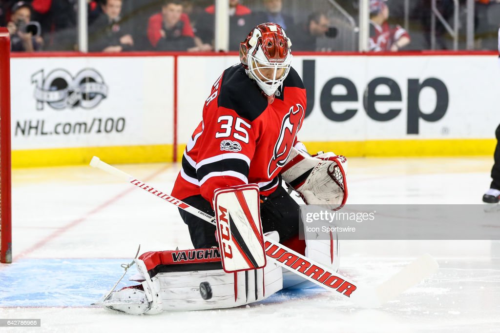 4275cb877 ... New Jersey Devils goalie Cory Schneider (35) makes a save during the  third period ...