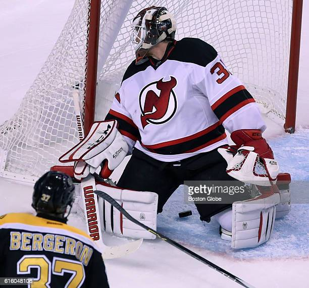 New Jersey Devils goaltender Cory Schneider has no idea that the puck is between his legs and headed for the net but he was lucky to realize it at...