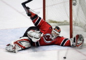 New Jersey Devils' goaltender Martin Brodeur makes a save against the New York Rangers during the third period of game two in the first round of the...
