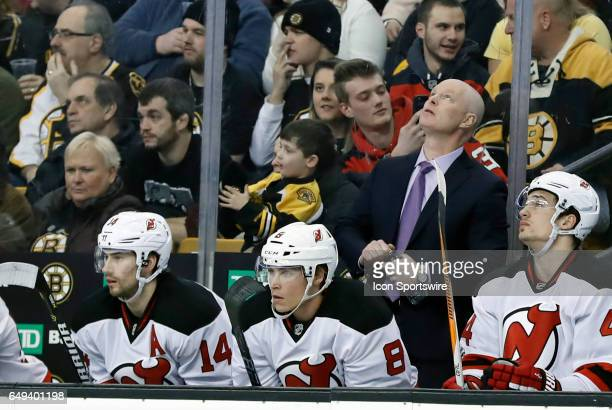 New Jersey Devils head coach John Hynes checks the clock during a regular season NHL game between the Boston Bruins and the New Jersey Devils on...