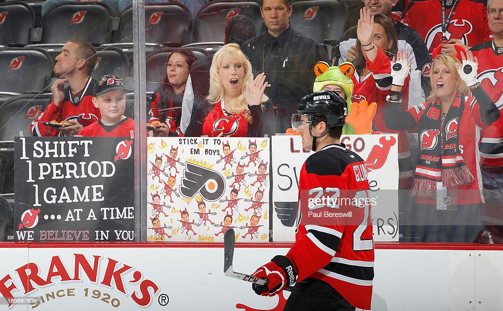 New Jersey Devils hold up signs before a hockey game against the Philadelphia Flyers at Prudential Center on November 2, 2013 in Newark, New Jersey.