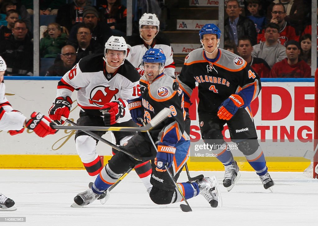 New Jersey Devils <a gi-track='captionPersonalityLinkClicked' href=/galleries/search?phrase=Jacob+Josefson&family=editorial&specificpeople=5648065 ng-click='$event.stopPropagation()'>Jacob Josefson</a> #16 and <a gi-track='captionPersonalityLinkClicked' href=/galleries/search?phrase=Steve+Bernier&family=editorial&specificpeople=557040 ng-click='$event.stopPropagation()'>Steve Bernier</a>#18 along with New York Islanders <a gi-track='captionPersonalityLinkClicked' href=/galleries/search?phrase=Jay+Pandolfo&family=editorial&specificpeople=202871 ng-click='$event.stopPropagation()'>Jay Pandolfo</a> #29 and Mark Eaton #4 watch the puck as it's cleared at Nassau Veterans Memorial Coliseum on March 4, 2012 in Uniondale, New York.