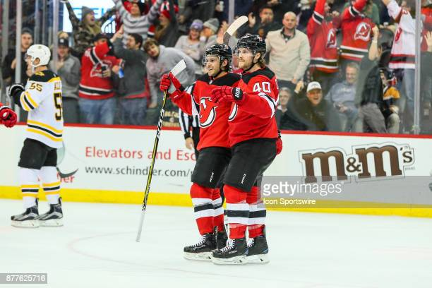 New Jersey Devils left wing Brian Gibbons celebrates with teammate New Jersey Devils center Blake Coleman during the National Hockey League game...