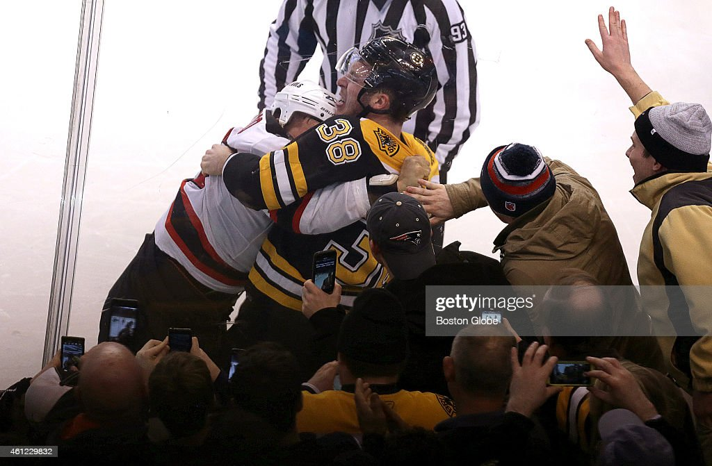 New Jersey Devils right wing Jordin Tootoo and Boston Bruins left wing Jordan Caron tussle which was enough to bring out the camera phones for these...