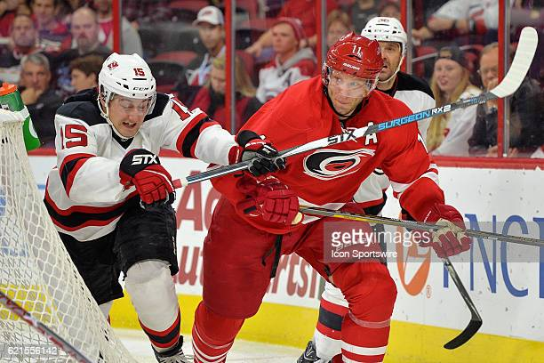 New Jersey Devils Right Wing Reid Boucher chases Carolina Hurricanes Center Jordan Staal in a game between the Carolina Hurricanes and the New Jersey...