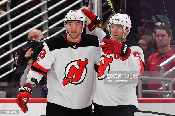 New Jersey Devils right wing Stefan Noesen and New Jersey Devils defenseman Andy Greene celebrate after the New Jersey Devils center Nico Hischier...