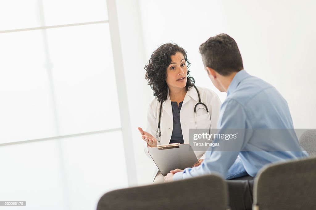USA, New Jersey, Doctor talking to patient